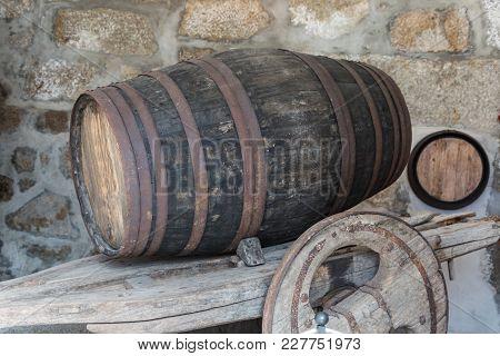 Big Oak Barrel In Horizontal Position On Wooden Cart.