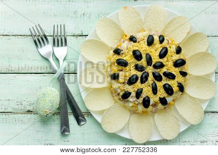 Sunflower Salad Decorated With Potato Chips, Corn, Egg And Olive For Festive Easter Dinner