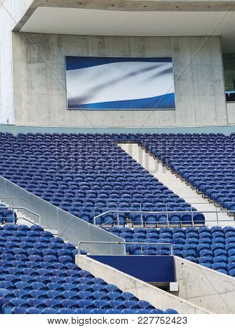 Stadium Bleachers: Blue Empty Seating Inside Stadium For Sports Events-