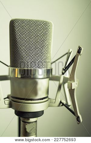 Professional Microphone Silver On White Background In Studio