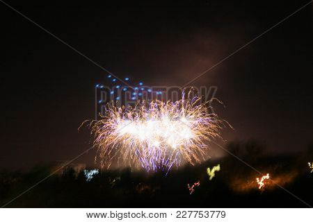 Colorful Fireworks Exploding In The Night Sky. Celebration
