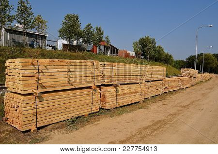 Stacks Of Rough Sawed Dimension Lumber Are Banded And Waiting For Transport
