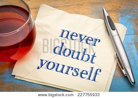 Never doubt yourself  - handwriting on a napkin with a cup of tea