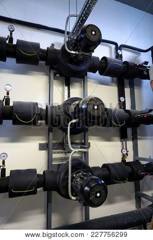 Heating System In A Boiler Room. Powerful Pumps