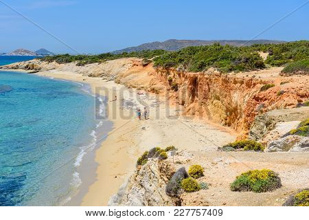 Naxos, Greece - May 24, 2017: Tourists Sunbathing On Aliko Beach, One Of The Best Beaches On The Sou