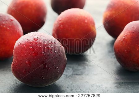 Nectarines Fruit With Water Drops On Grey Wooden Table