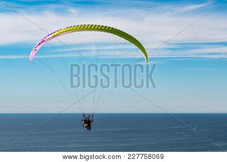 La Jolla, California - February 17, 2018:  A Pilot Sails High Over The Pacific Ocean After Launching