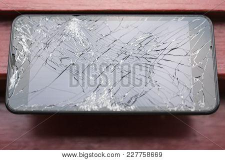 Broken Glass Mobile Phone Screen In Black