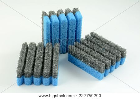 Grooved Sponges For Leaning Non Stick Grill Without Scratching Surface On White Background