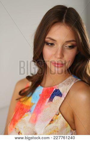 Beautiful Female In Sundress Posing On White Background