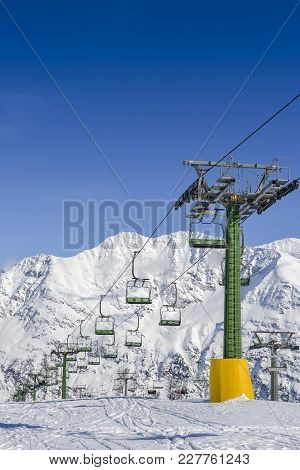 Chairlift At Snow Covered Italian Ski Area In The Alps - Winter Sports Concept With Copy Space
