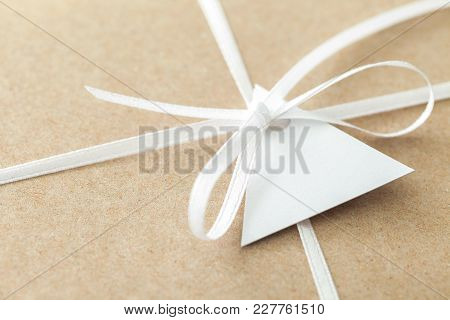 Close Up Of Ribbon And Label Of Envelope From Craft Paper.
