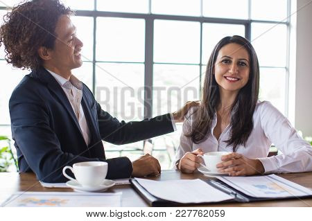 Cheerful Mixed-race Businessman Praising His Female Coworker. Entrepreneur Congratulating His Busine