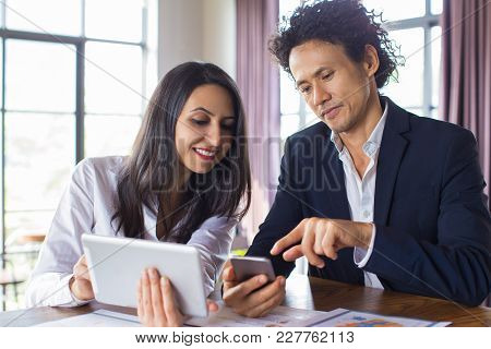 Cheerful Colleagues Surfing Net While Preparing Report. Smiling Business Lady Watching Online Statis