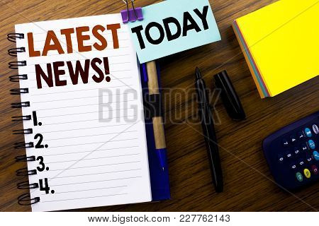 Word, Writing Latest News. Business Concept For Fresh Current New Story Written On Book Note Paper O