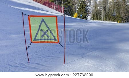 Signpost With Warning On Ski Piste