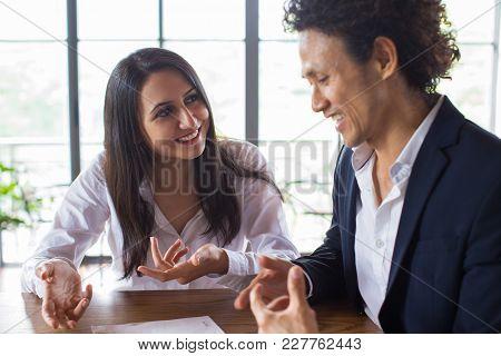 Digital Nomads Having Informal Business Meeting In Cafe. Business Partners Sharing Secrets Of Succes