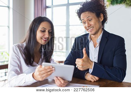 Excited Entrepreneur Approving Idea Of His Female Business Partner. Happy Businessman Showing Thumbs