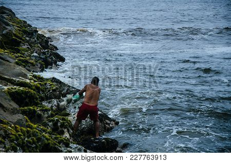 Fisherman Throwing His Net To Catch Some Fish