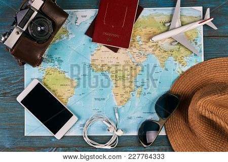 Passport, Photo Camera, Smart Phone, Sunglasses, Straw Hat And Travel Map, Traveler Items Vacation T