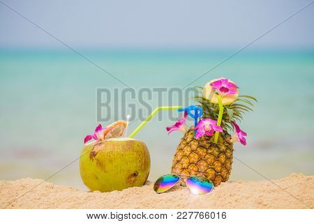 Purple Orchid Flower Put On Fresh Pineapple Juice And Sliced Pineapple Fruit With Coconut Drink And