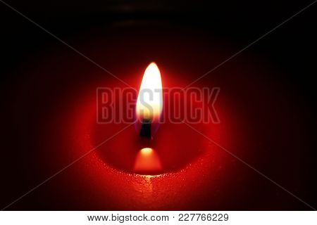 A View Of A Candle And Flame