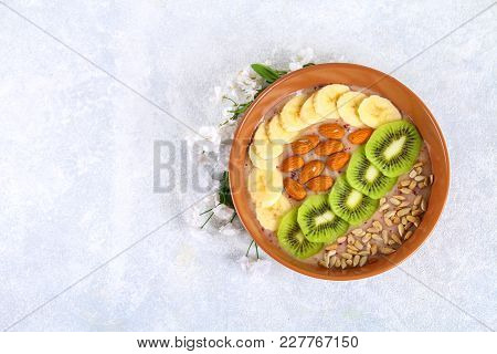 Breakfast Berry Smoothie Bowl Topped With Bananas, Berries, Kiwi, Almonds And Sunflower Seeds