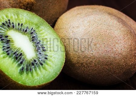 Kiwi On A Wooden Background