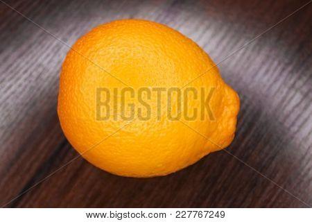Large Orange On A Wooden Background.