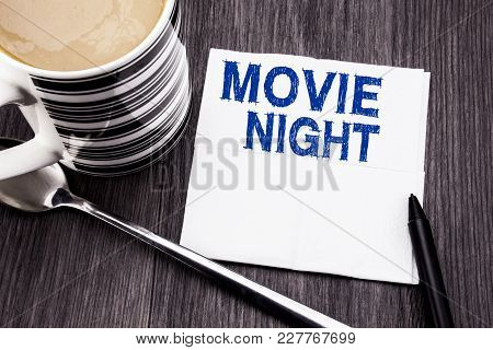 Handwritten Text Showing Movie Night. Business Concept For Wathing Movies  Written On Tissue Paper H