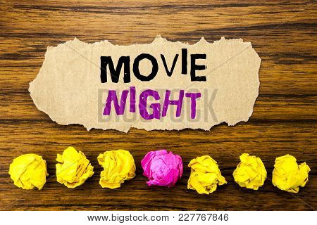 Handwriting Text   Movie Night. Concept For Wathing Movies  Written On Sticky Paper Reminder, Wooden