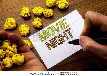 Word, Writing Movie Night. Concept For Wathing Movies  Written On Notebook Note Paper On Wooden Back