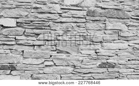 High Quality Grey Stone Wall Texture. Ancient Natural Cobblestone Road As Background.