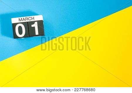 March 1st. Day 1 Of March Month, Calendar On Blue And Yellow Background Flat Lay, Top View. Spring T