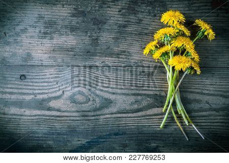 Bouquet Of Yellow Dandelions On Dark Gray Wooden Background, Space For Text