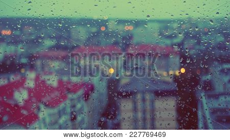 City View, Window And Rain Drops. Abstract Background. Evening View From A Window.