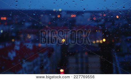 Evening City, Window And Rain Drops. Abstract, Background. Evening View From A Window.