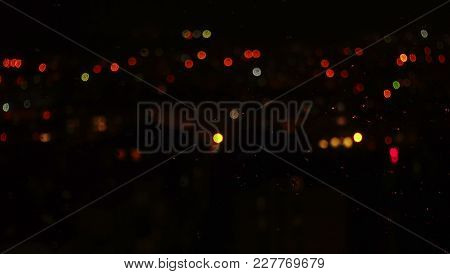 Abstract Background. Night City, Window And Rain Drops. Night View From A Window.