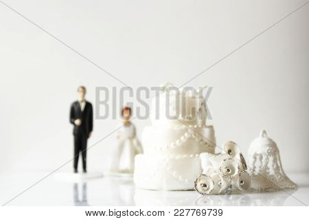 Wedding Décor In Foreground With Man And Wife In Background. Copy Space.