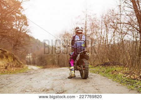 Professional Motocross Rider On Fmx Motorcycle Drives On The Sand Dune And Stops There To Admire Sce