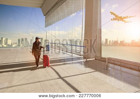 Traveling Woman With Belonging Luggage Walking In Airport Terminal Building And Passenger Plane Flyi