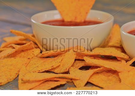 Chili Corn-chips With Salsa Dip On Wooden Background.