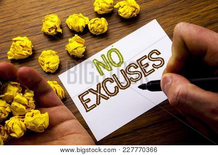 Word, Writing No Excuses. Concept For Stop Ban For Excuse Written On Notebook Note Paper On Wooden B