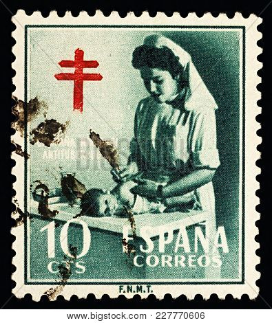 Moscow, Russia - February 21, 2018: A Stamp Printed In Spain Shows Nurse With Child, Fight Against T