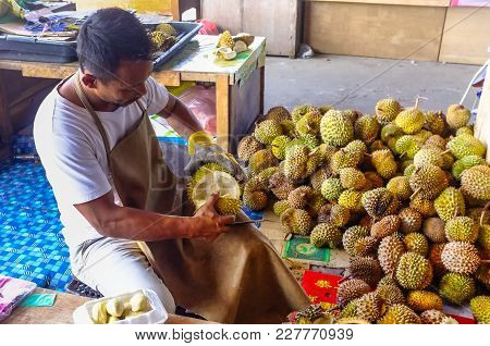 Kudat,sabah-feb 3,2018:vendor Of Durians,often Called The King Of Fruits Peels Fruits For Sale In Ku