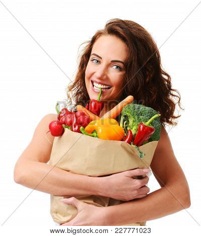 Young Woman Holding Grocery Paper Shopping Bag Full Of Fresh Vegetables. Diet Healthy Eating Concept