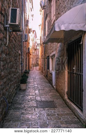 A Narrow Paved Street Of The Old Town Of Budva