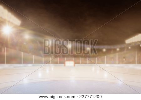 Brightly Lit Outdoor Ice Hockey Rink Arena With Focus On Foreground And Shallow Depth Of Field On Ba