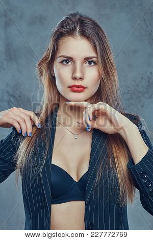 Studio Portrait Of A Sexy Slim Brunette In Black Lingerie And Shirt Posing On A Gray Background.