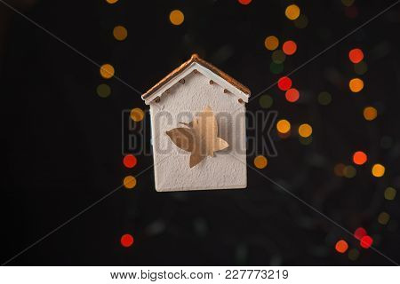 Paper Butterfly On A Model House On A Bokeh Light